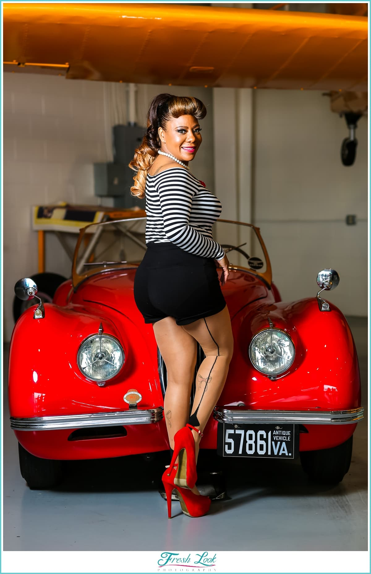 pinup model with vintage car