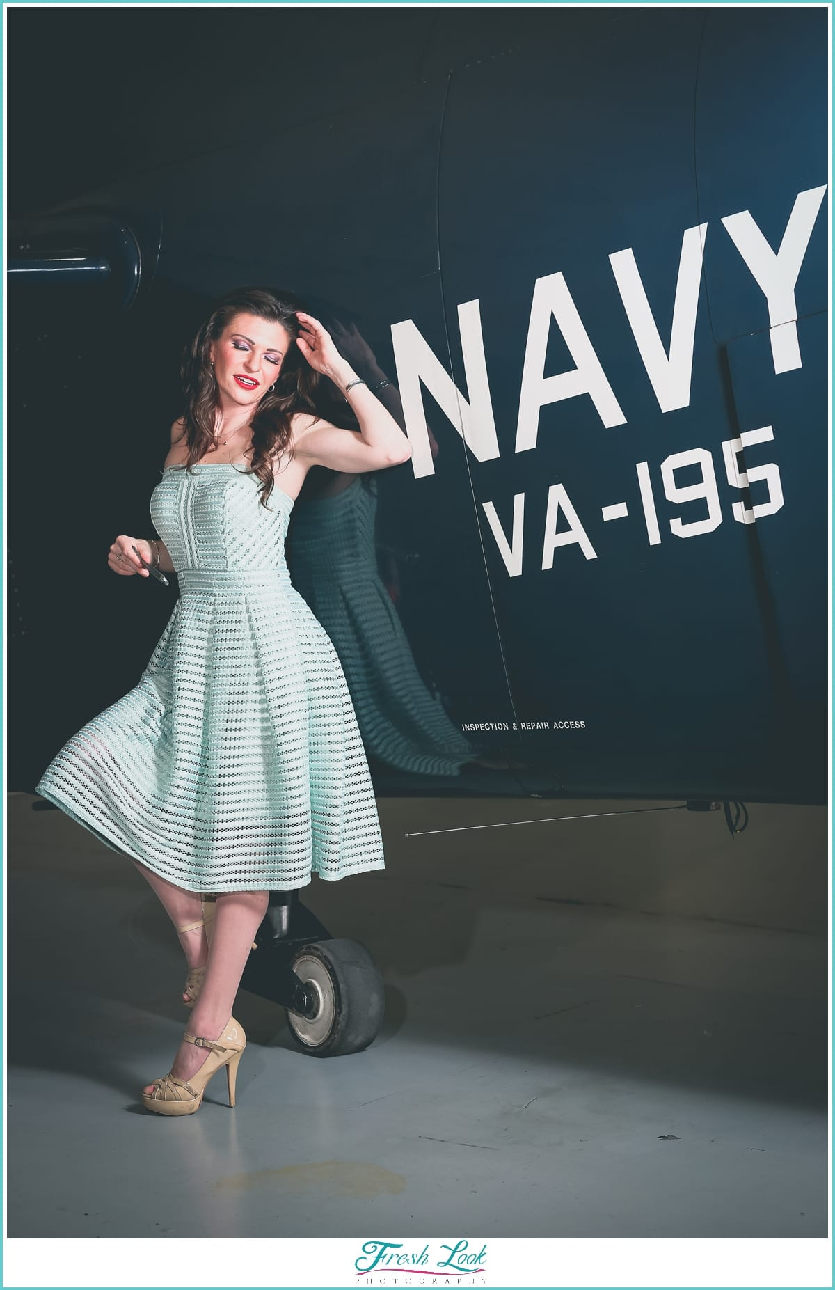 Vintage pin up vixen with Navy plane