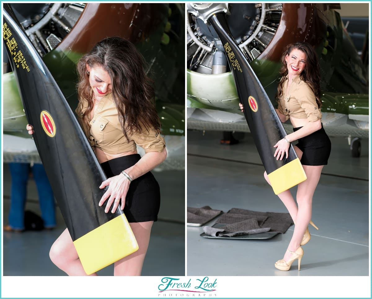 beautiful pinup model with world war II plane