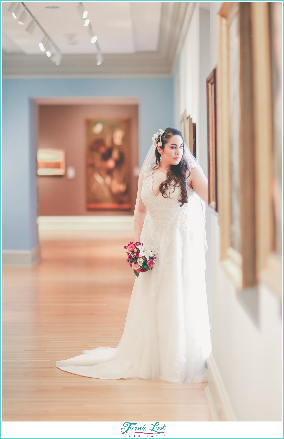 bridal portraits in blue art gallery