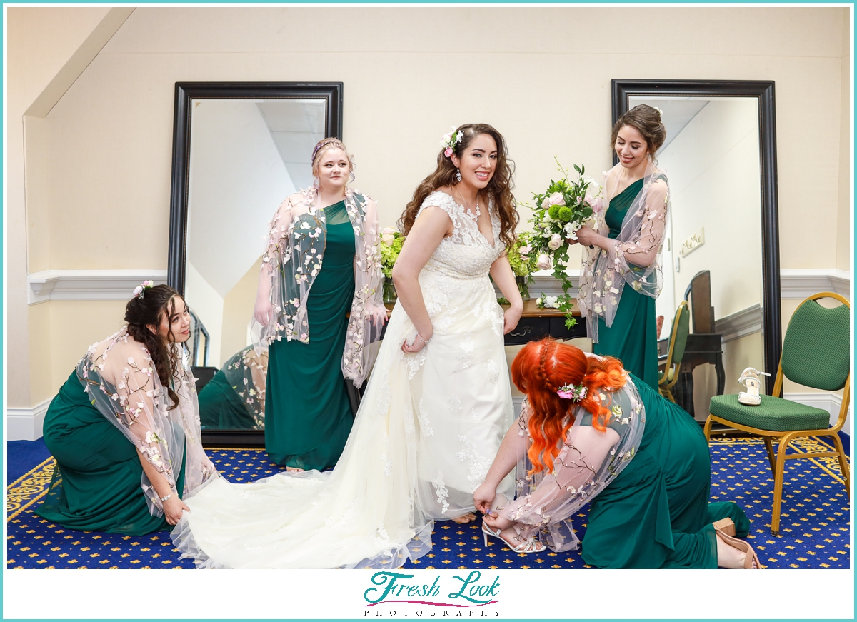 bridesmaids and bride getting ready for the wedding