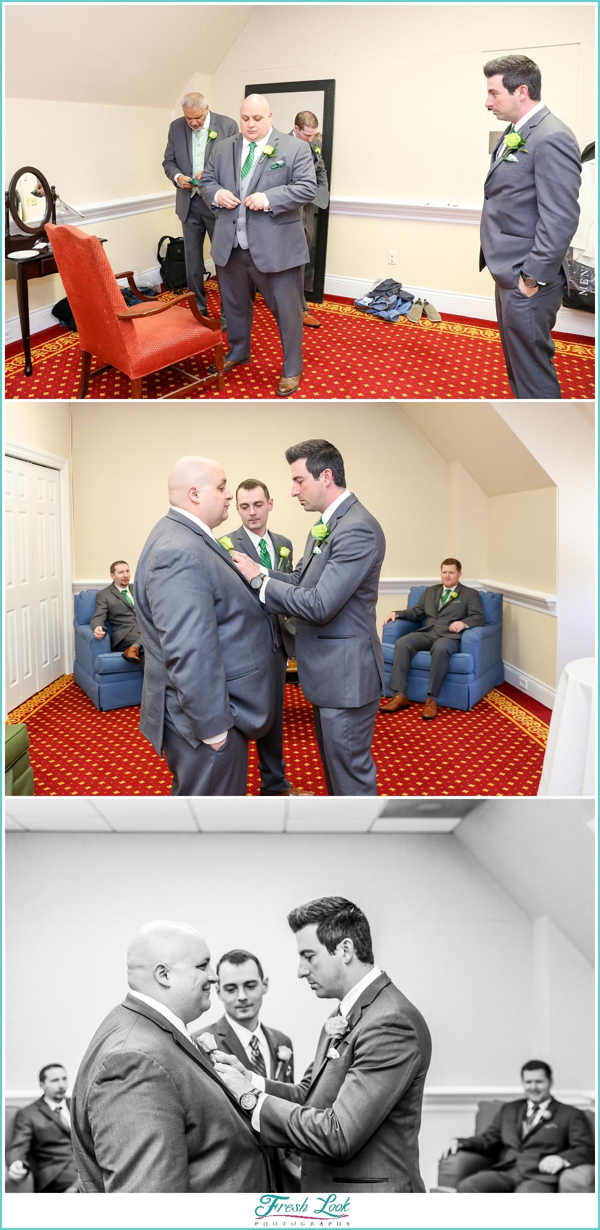 groom getting dressed for wedding