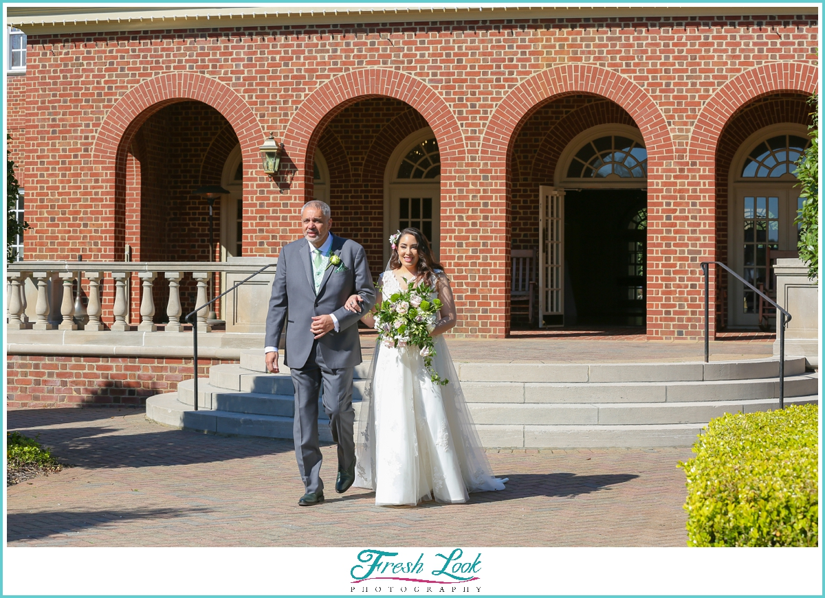 bride and her dad walking