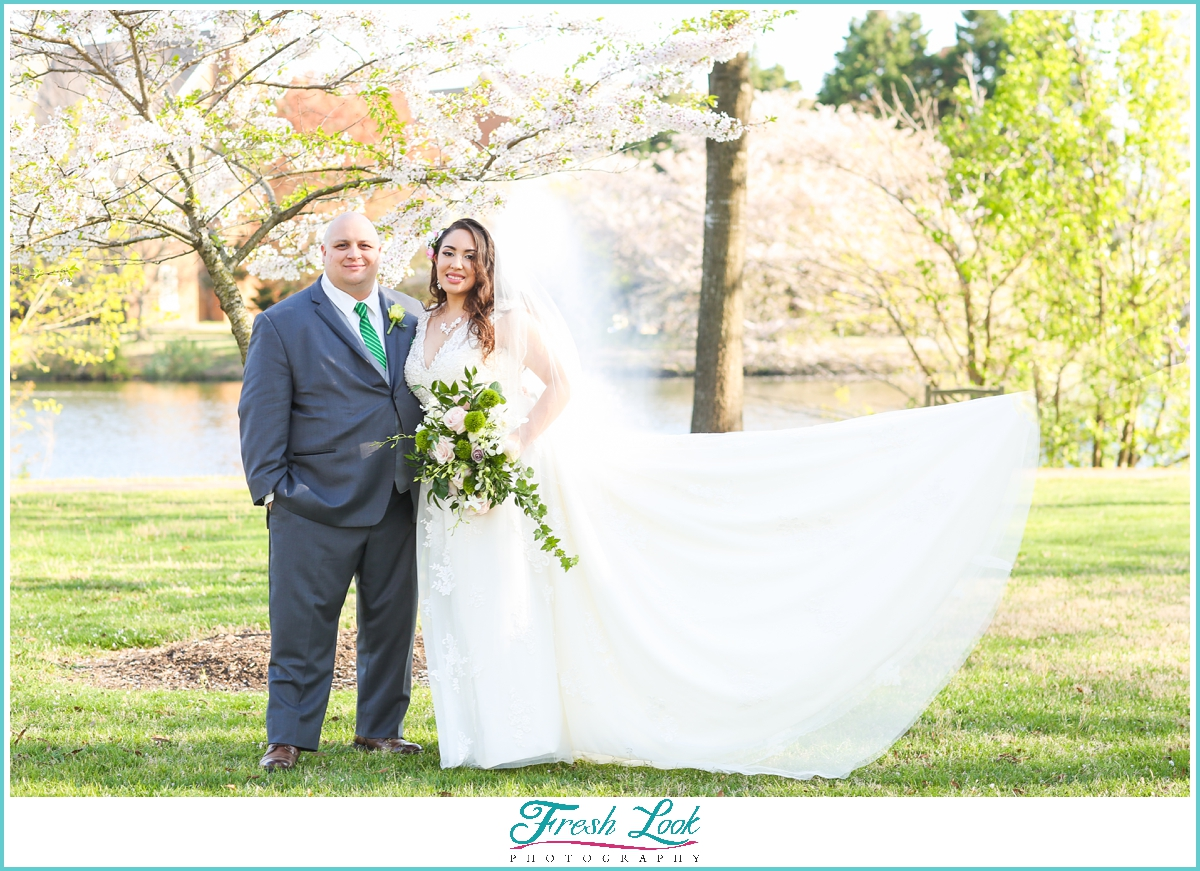 bride and groom with cherry blossom trees