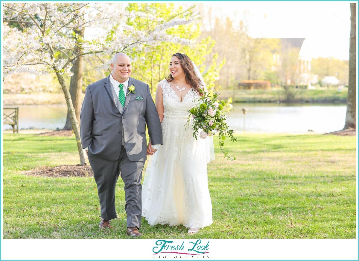 bride and groom walking in the garden
