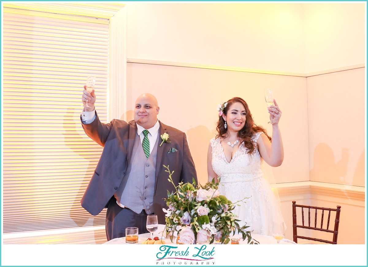 bride and groom toasting at the wedding