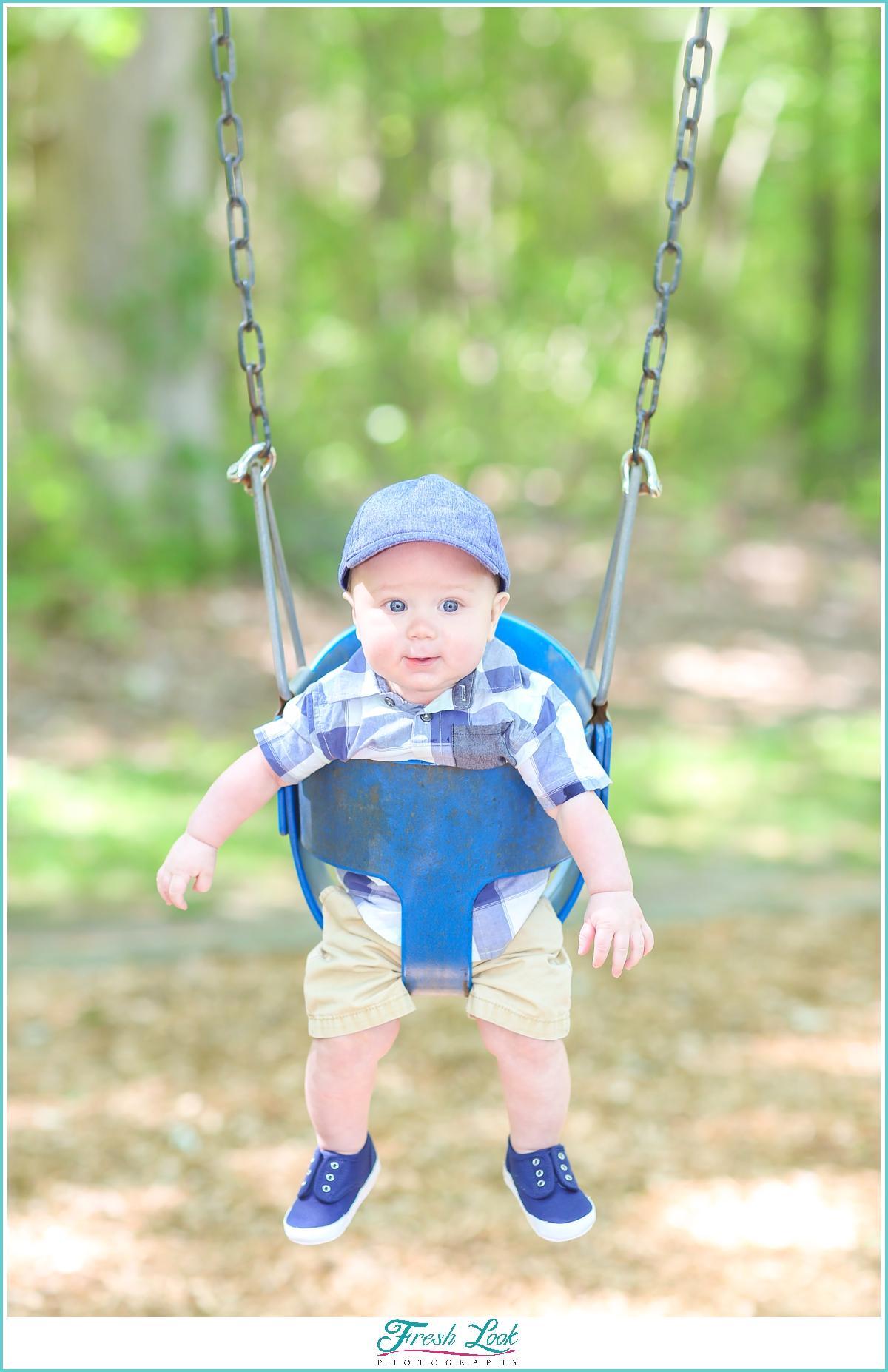 baby swinging on the swings