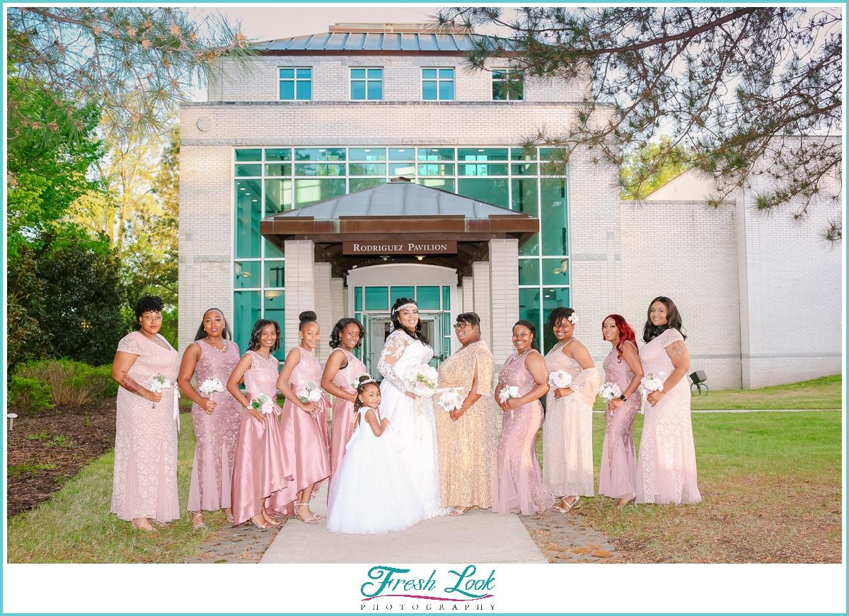 beautiful bridesmaids wearing blush and gold