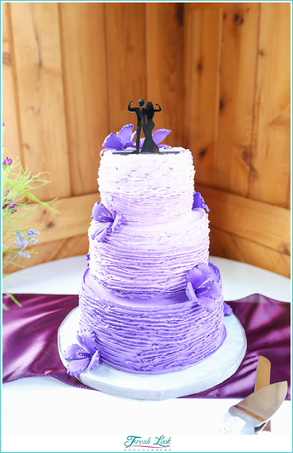 wedding cake with weightlifter topper