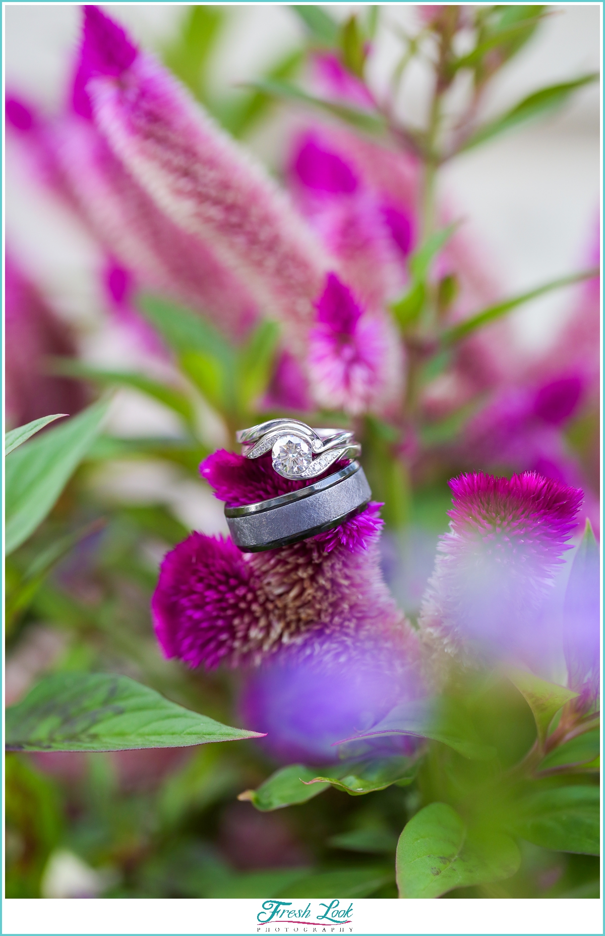 purple flowers and wedding rings