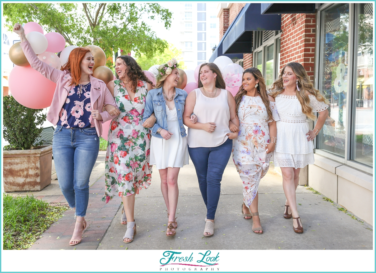 bride and bridesmaids walking together