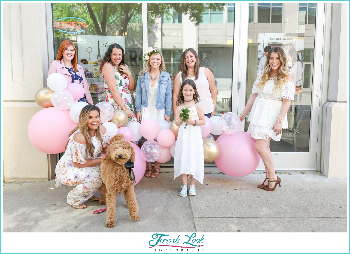 bride and bridesmaids with cute dog