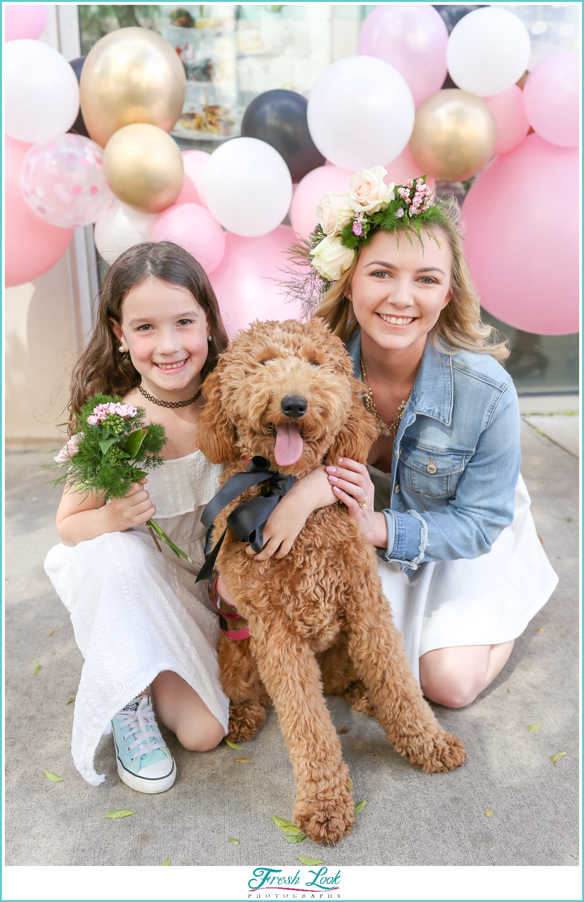 bride and flower girl with puppy dog