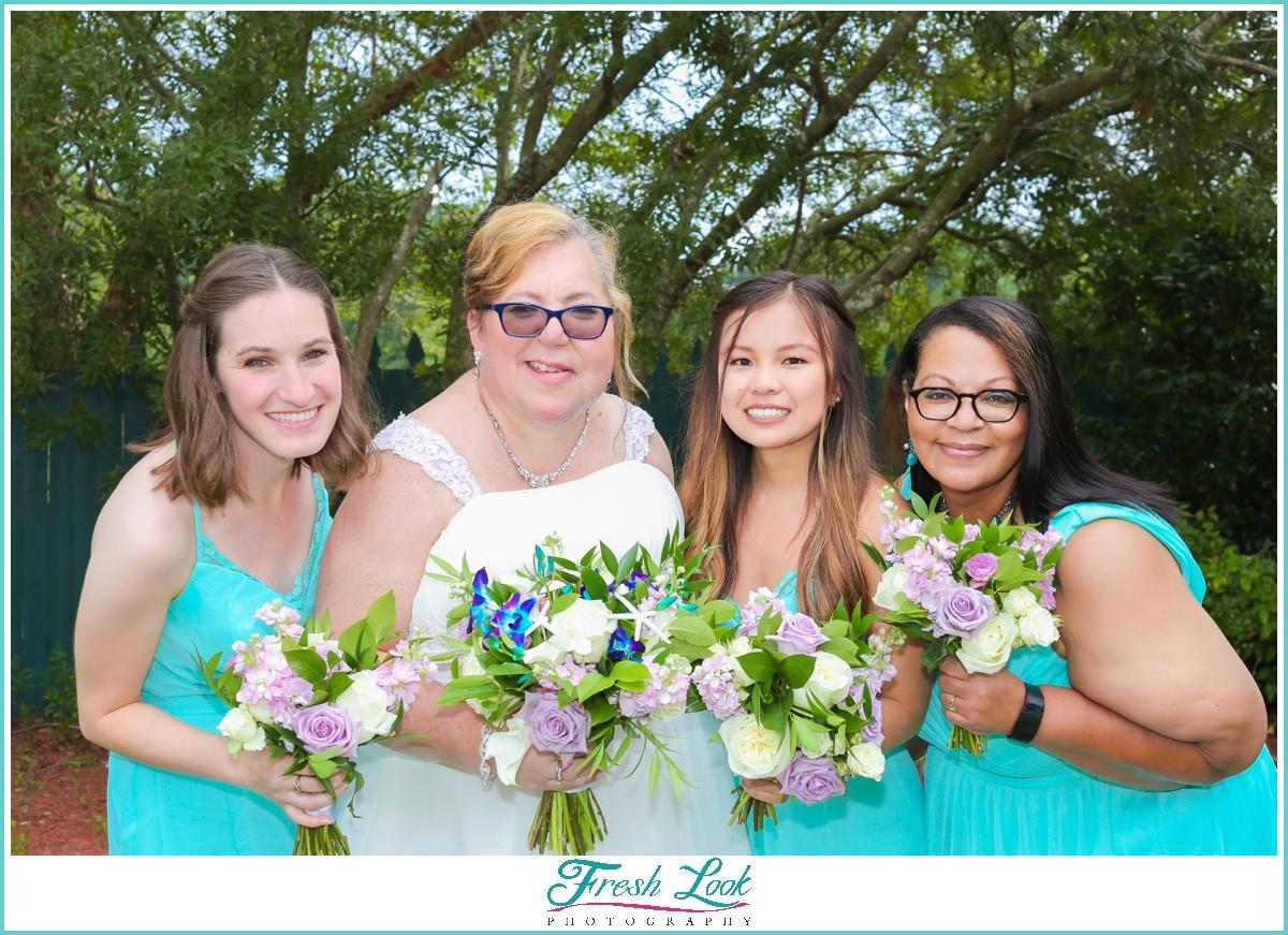bridesmaids wearing teal dresses