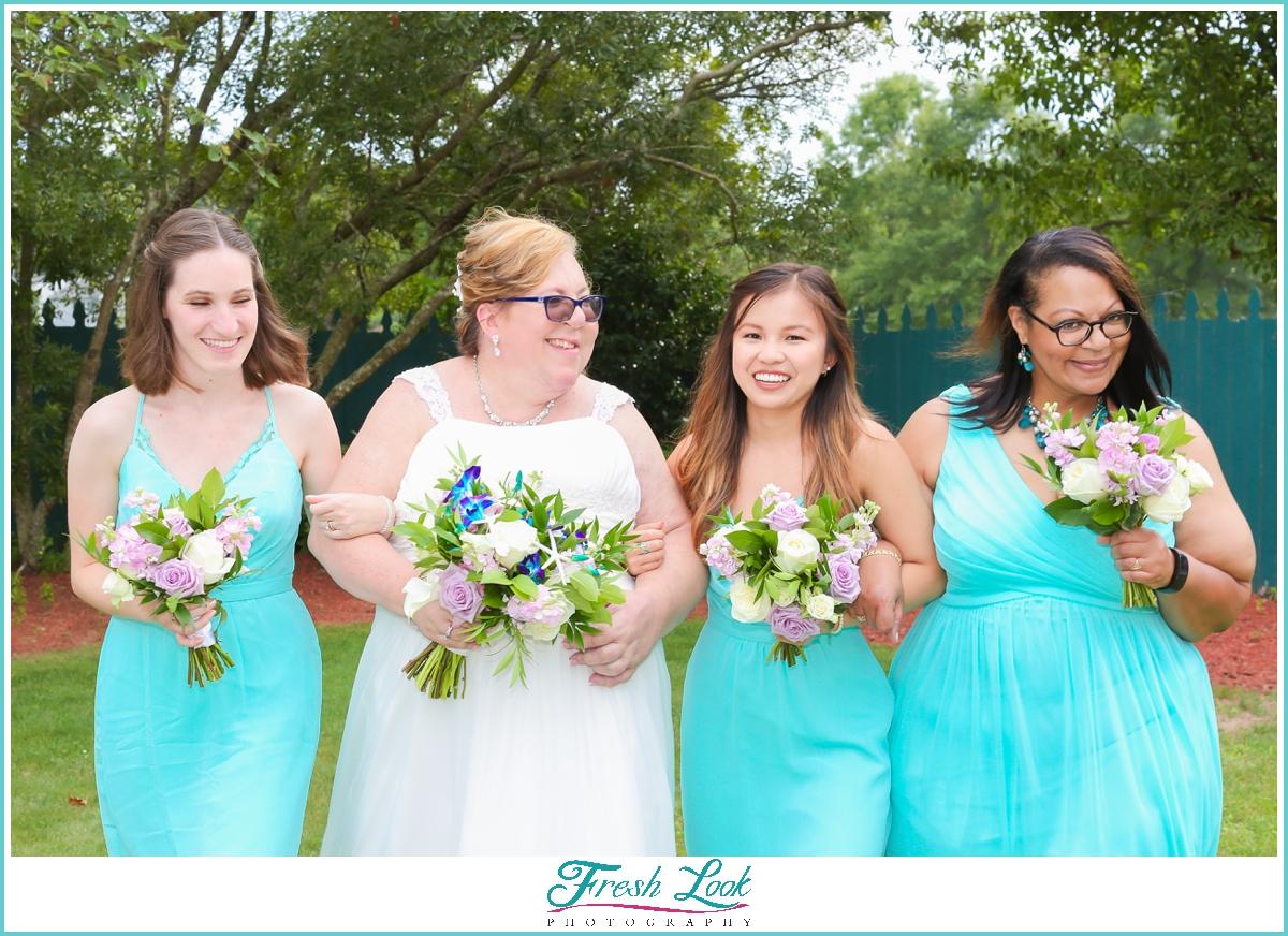 bridesmaids having fun with bride