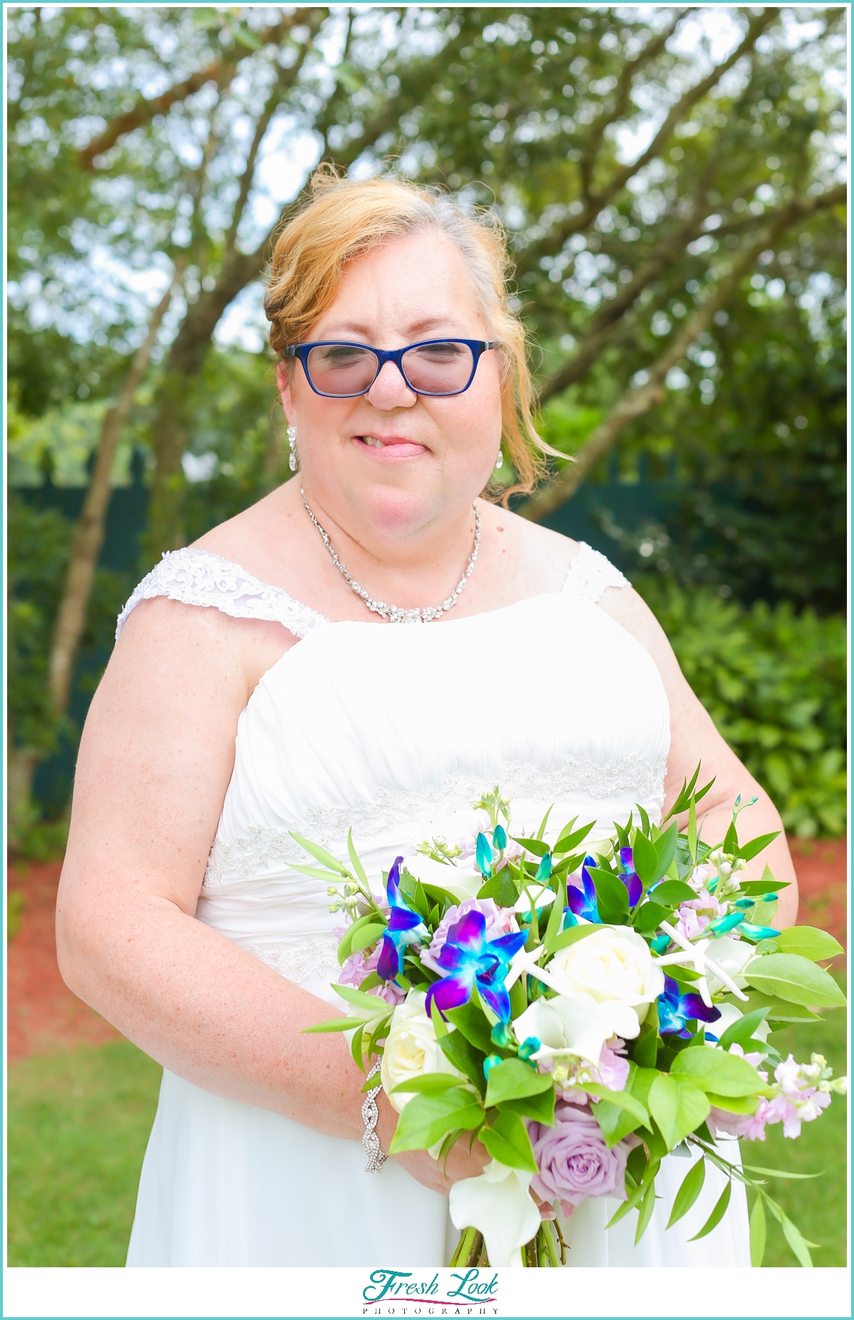 beautiful bride with tropical bouquet