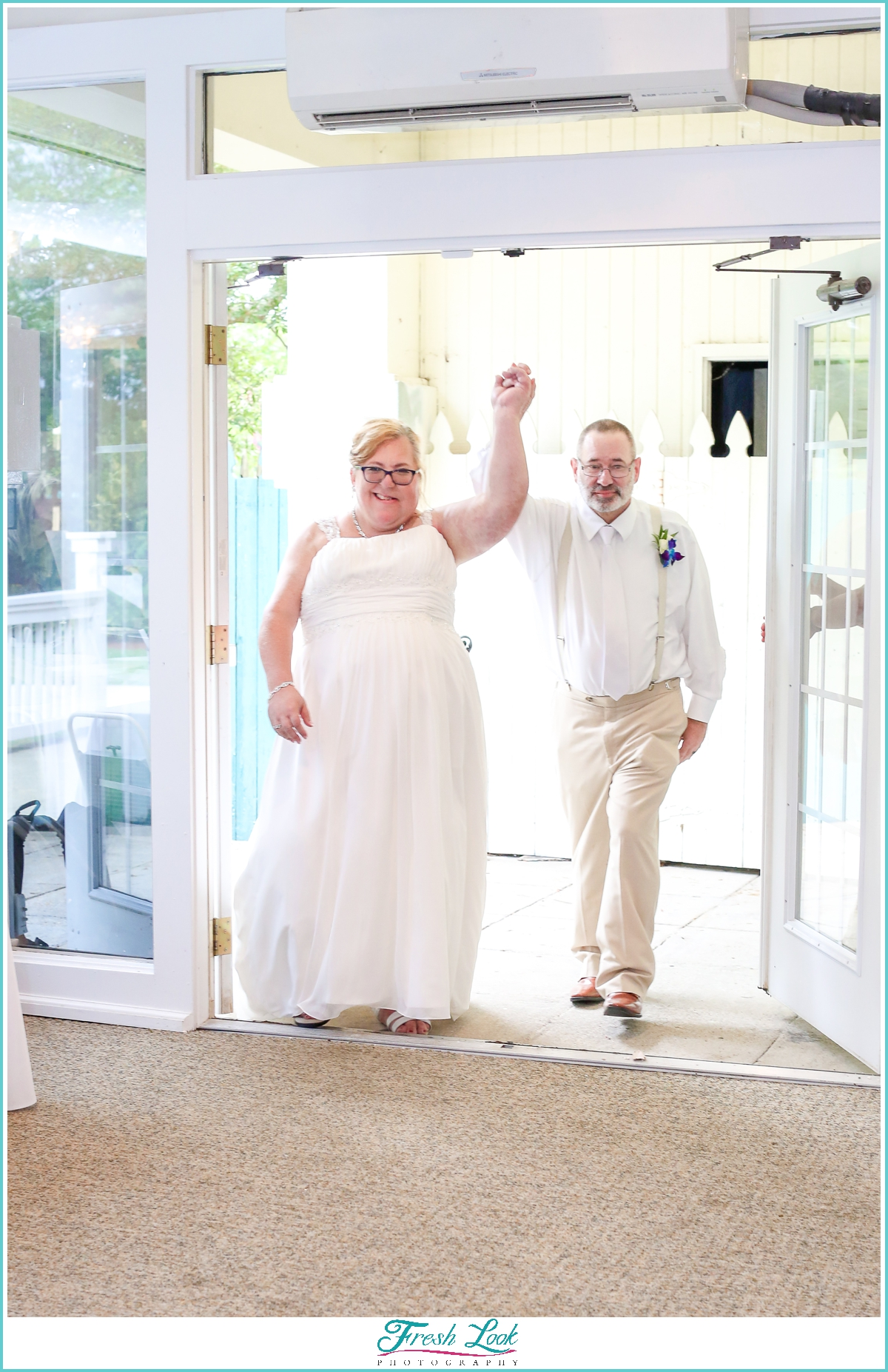 bride and groom grand entrance at reception