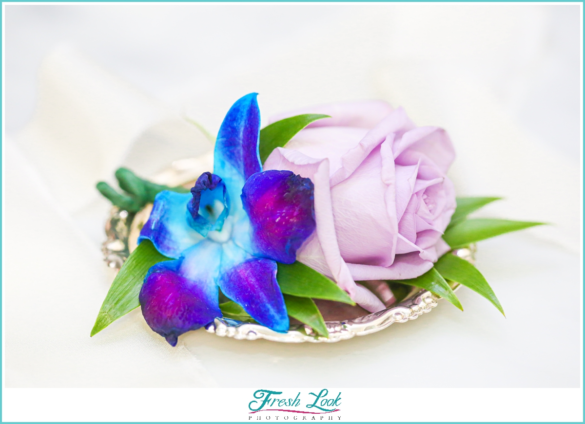 purple and blue boutonniere
