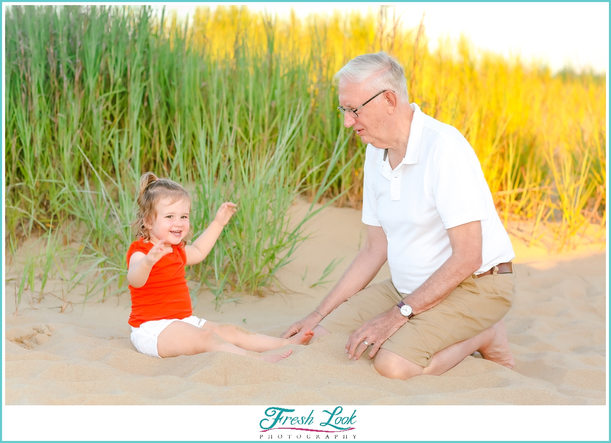 playing with grandpa in the sand