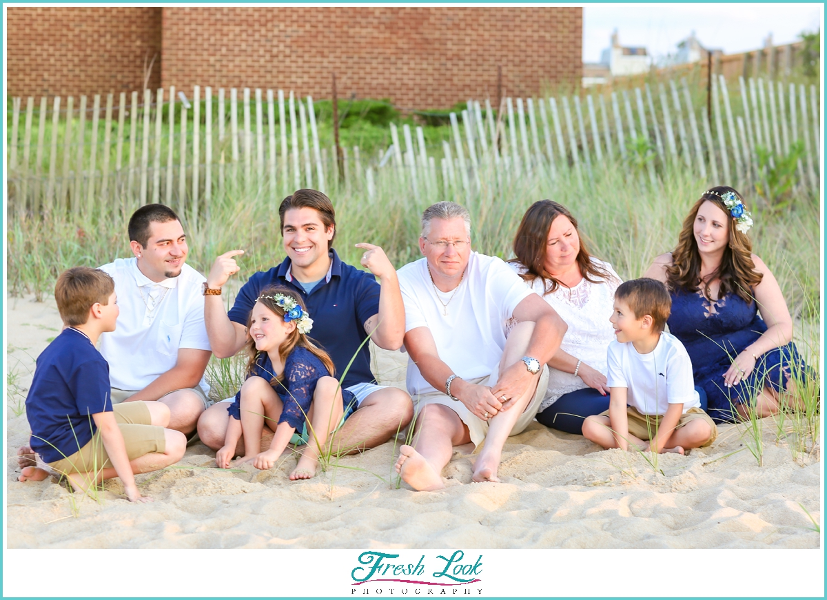 silly family photos on the beach