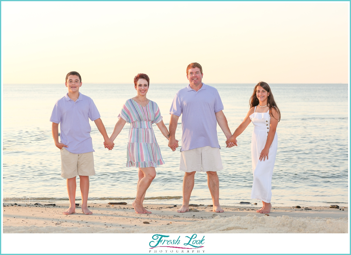 family of four on the beach