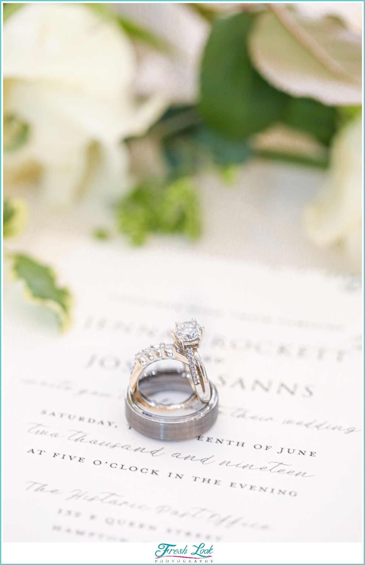 engagement ring and wedding stationery