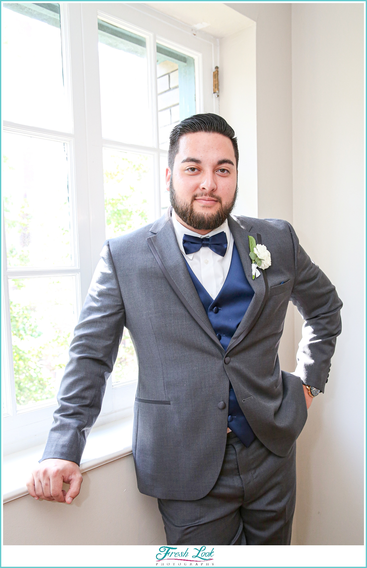 dapper groom wearing a gray suit