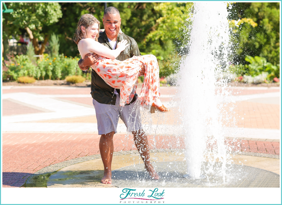 engagement shoot playing in the water