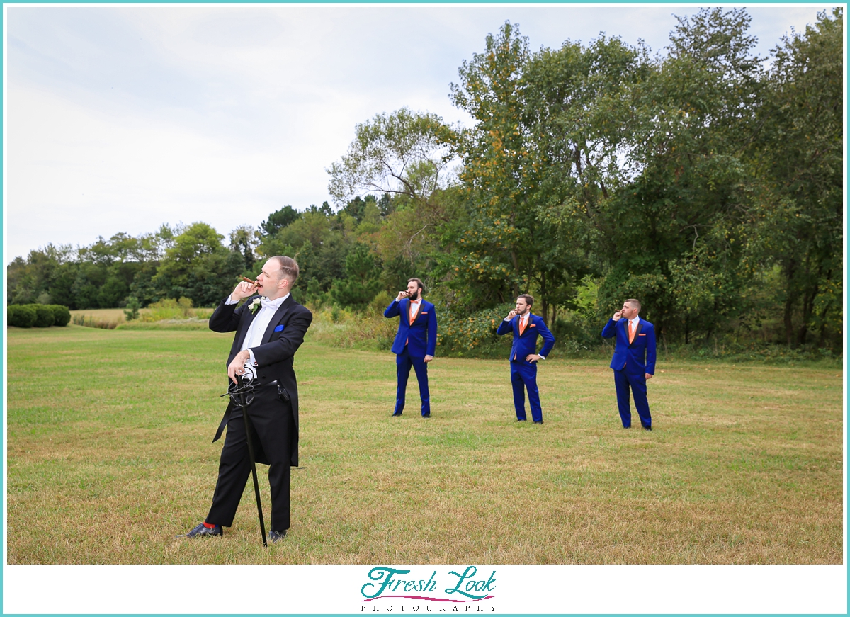 groom and groomsmen with cigar