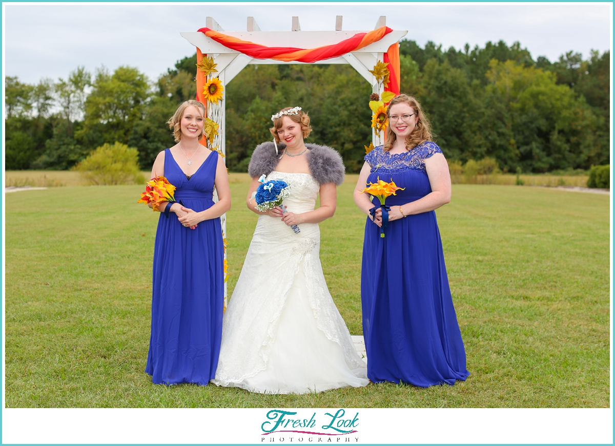 bride and bridesmaids in fall wedding