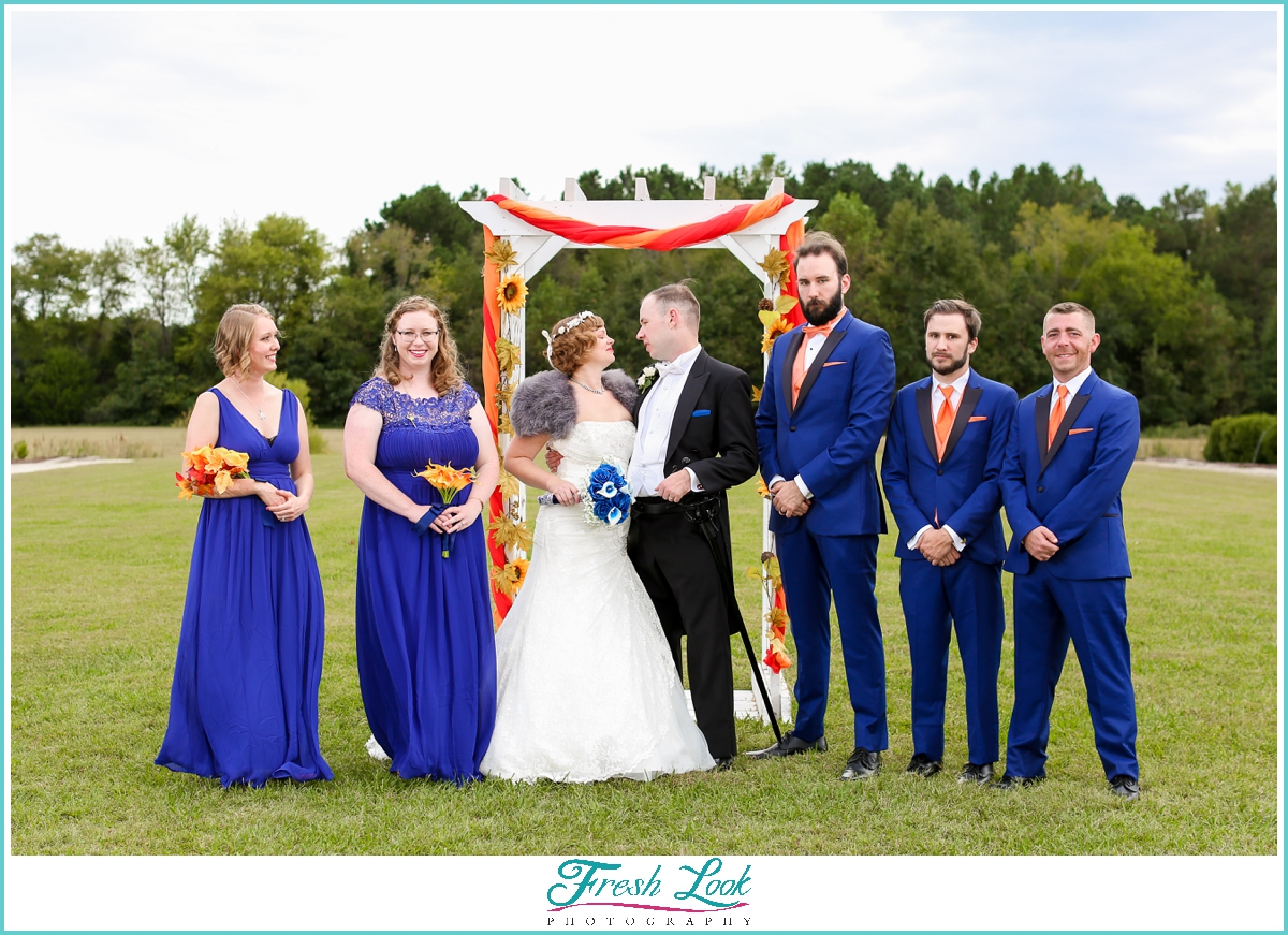 bridal party wearing blue and gray