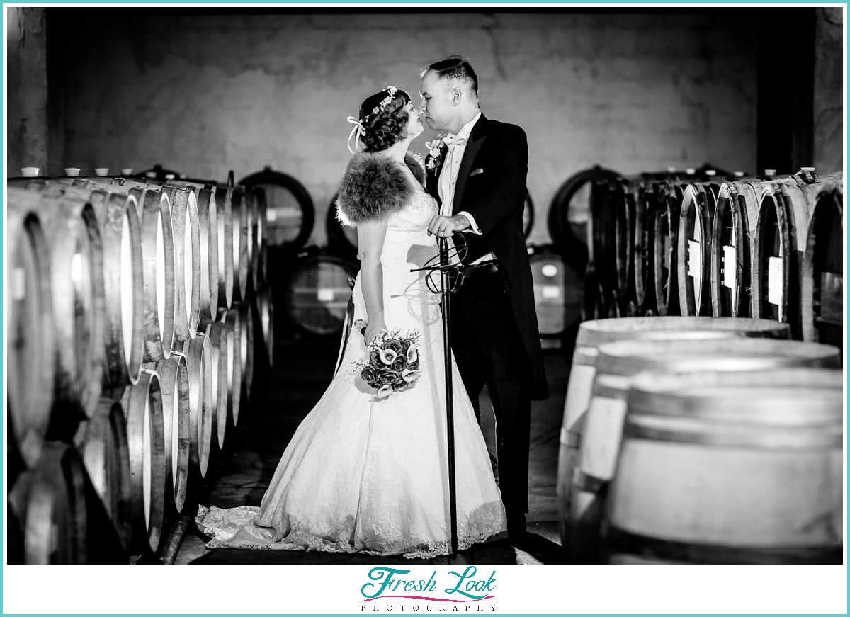 Winery cellar bride and groom portraits