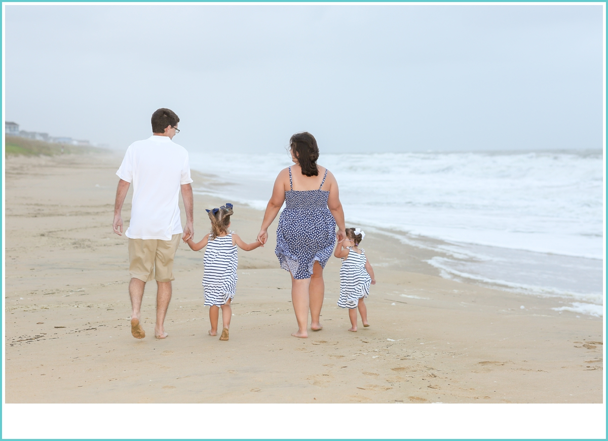 family walking on the beach together