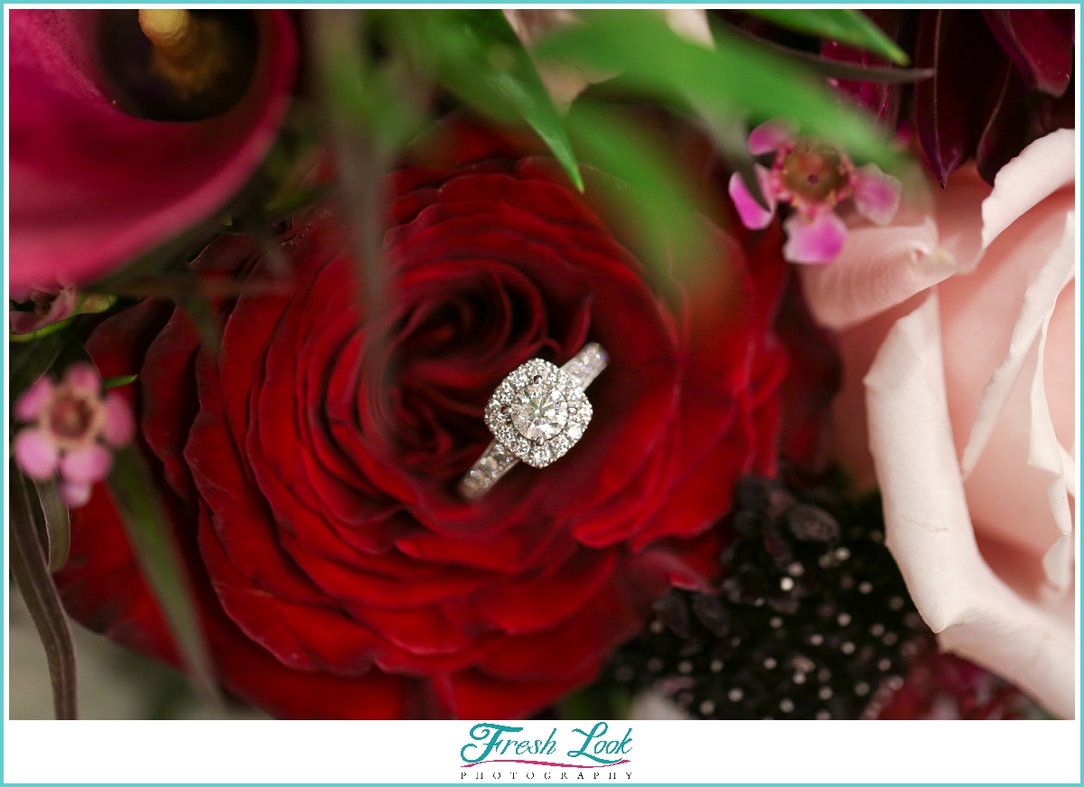 diamond engagement ring and roses
