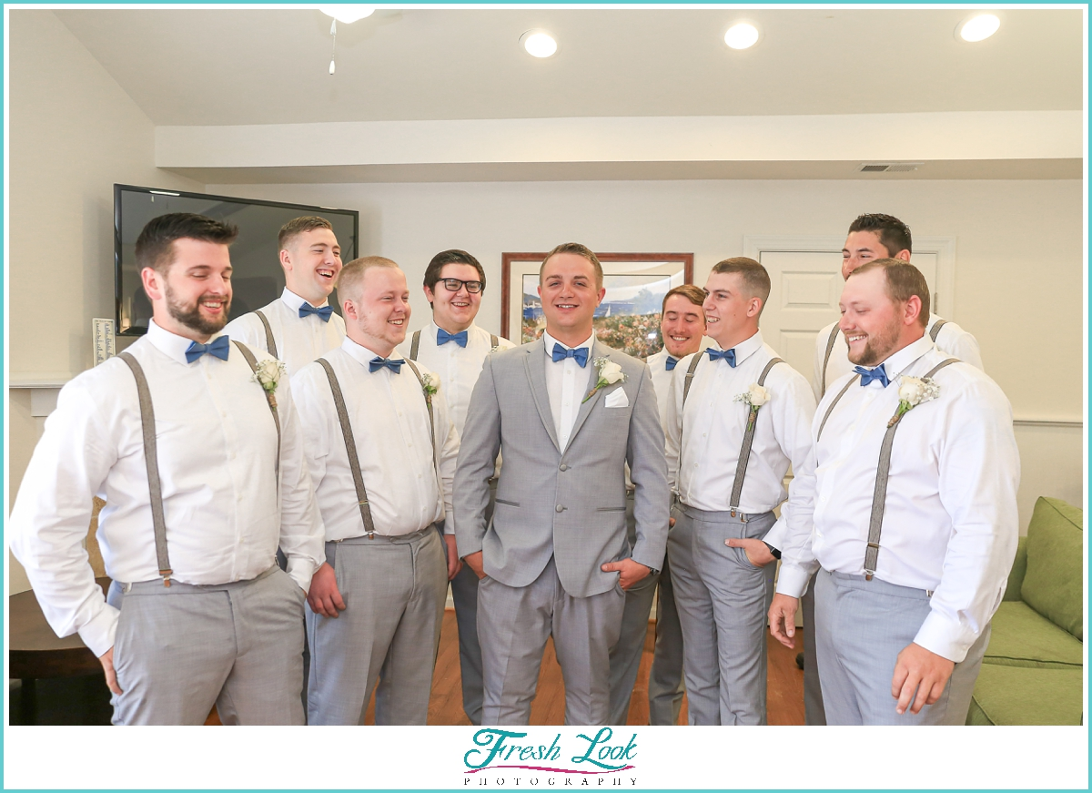 groom and groomsmen wearing gray suits