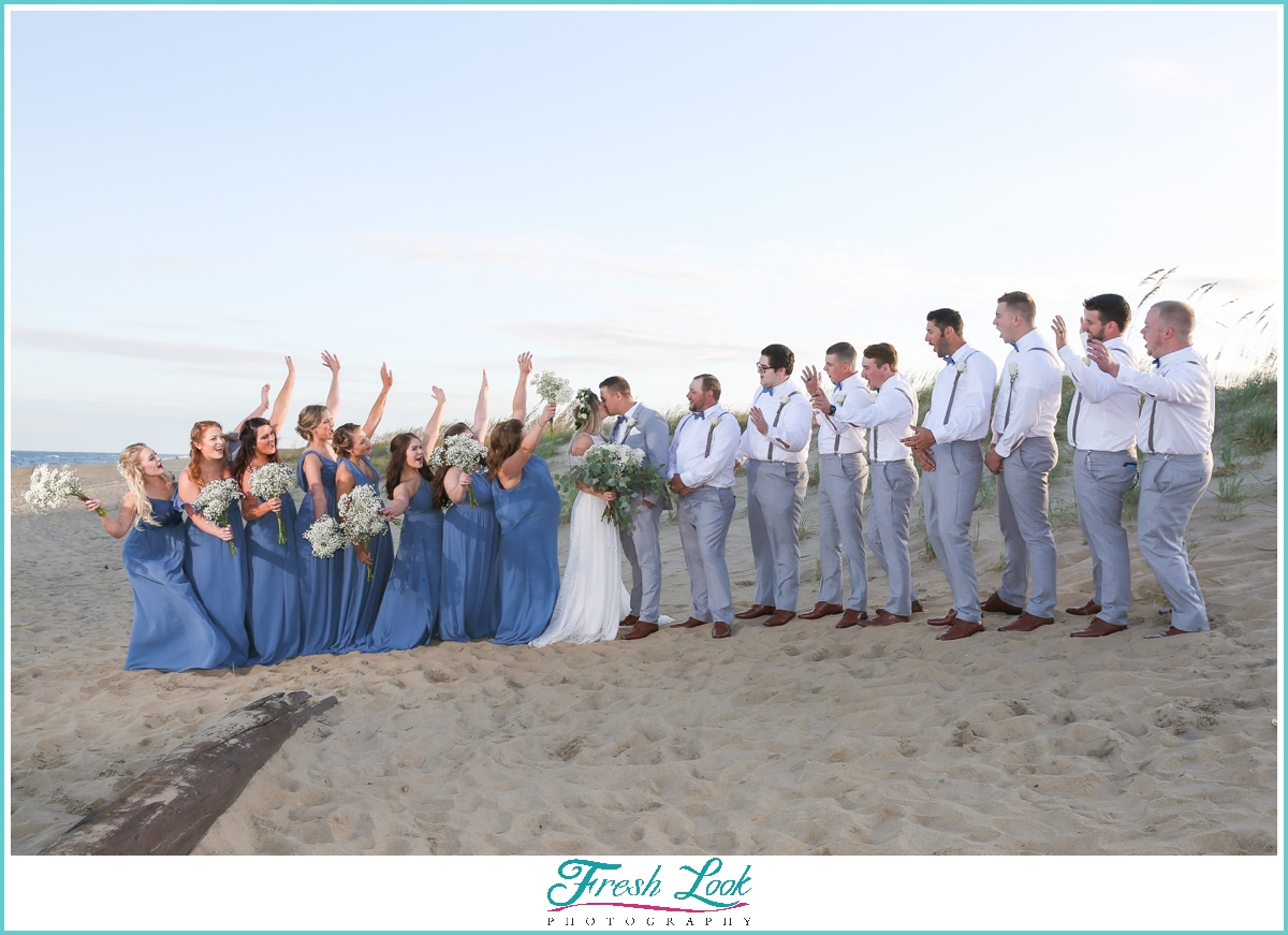 bridal party cheering bride and groom