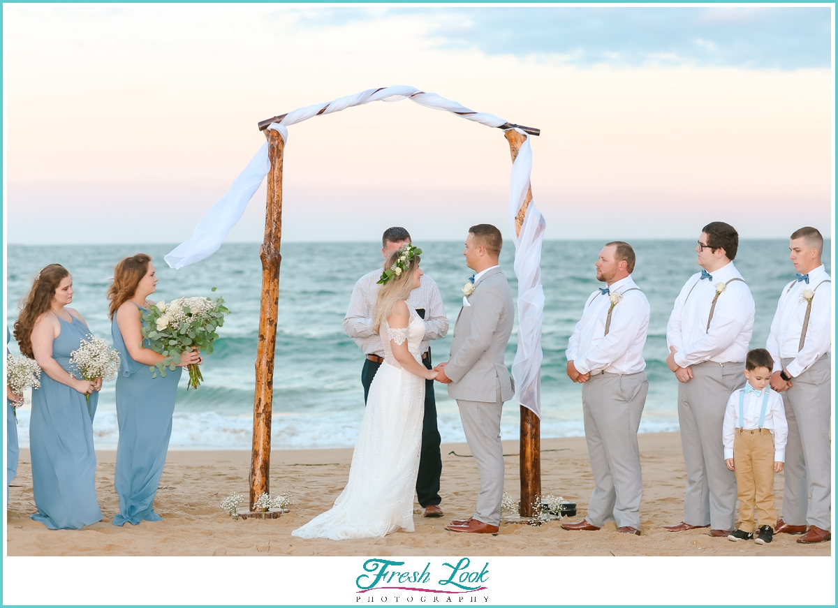 bride and groom at beach wedding ceremony