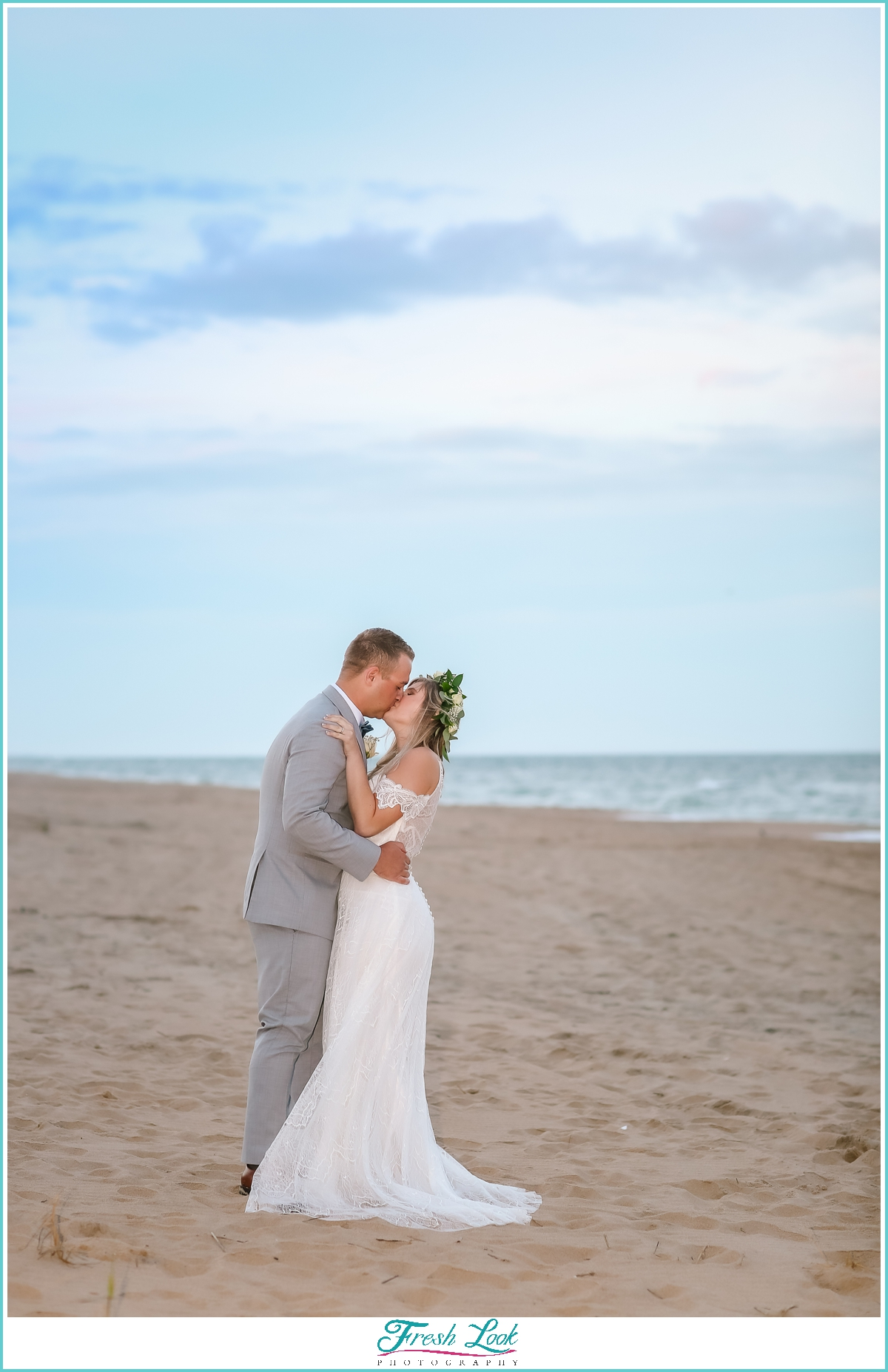 romantic beach wedding kiss