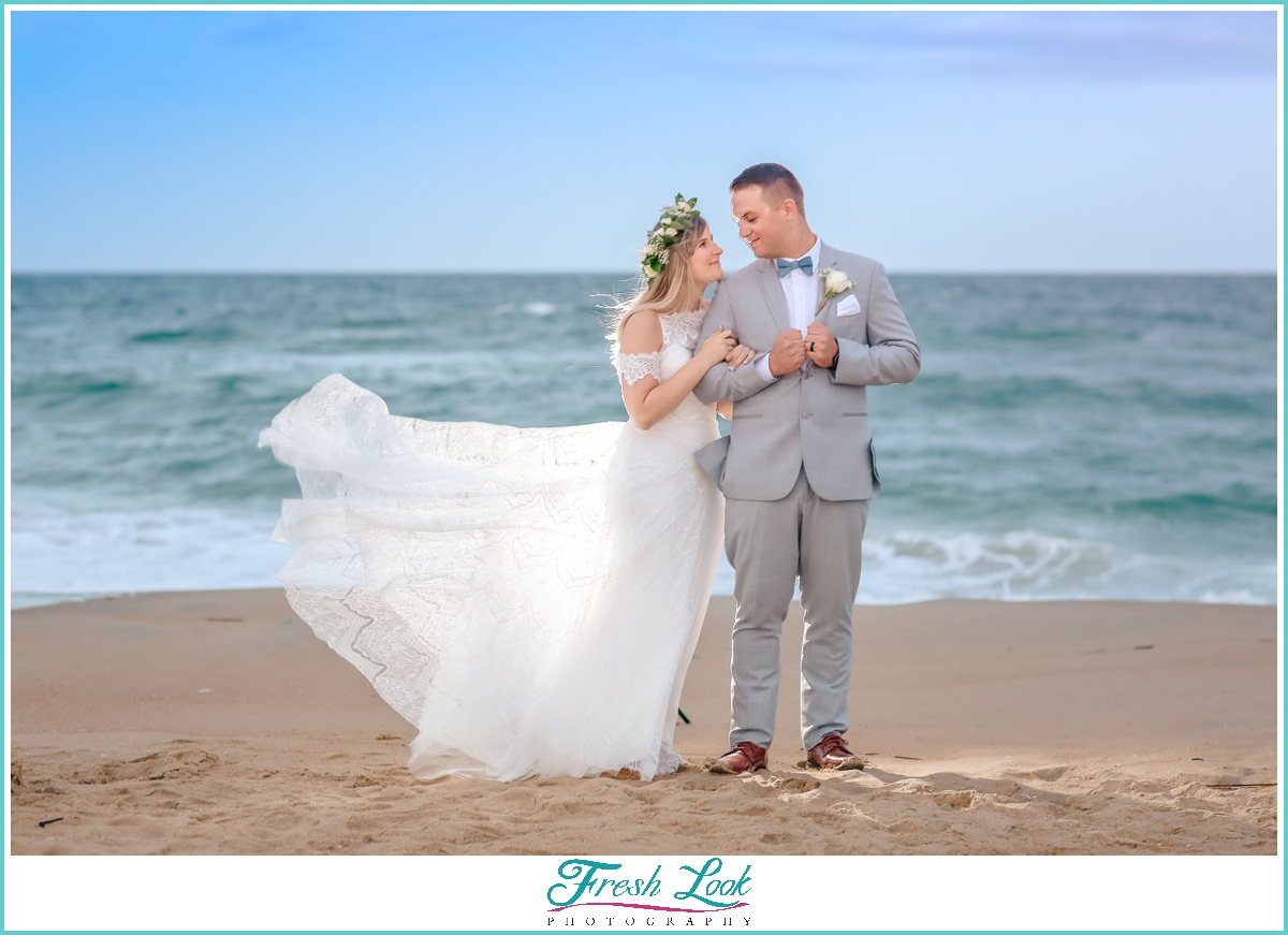 dramatic bride and groom portraits on the beach