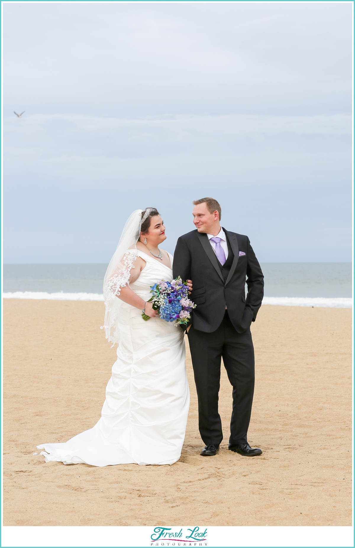 bride and groom first look on the beach