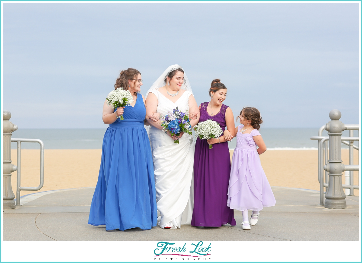 purple bridesmaids dresses on the beach