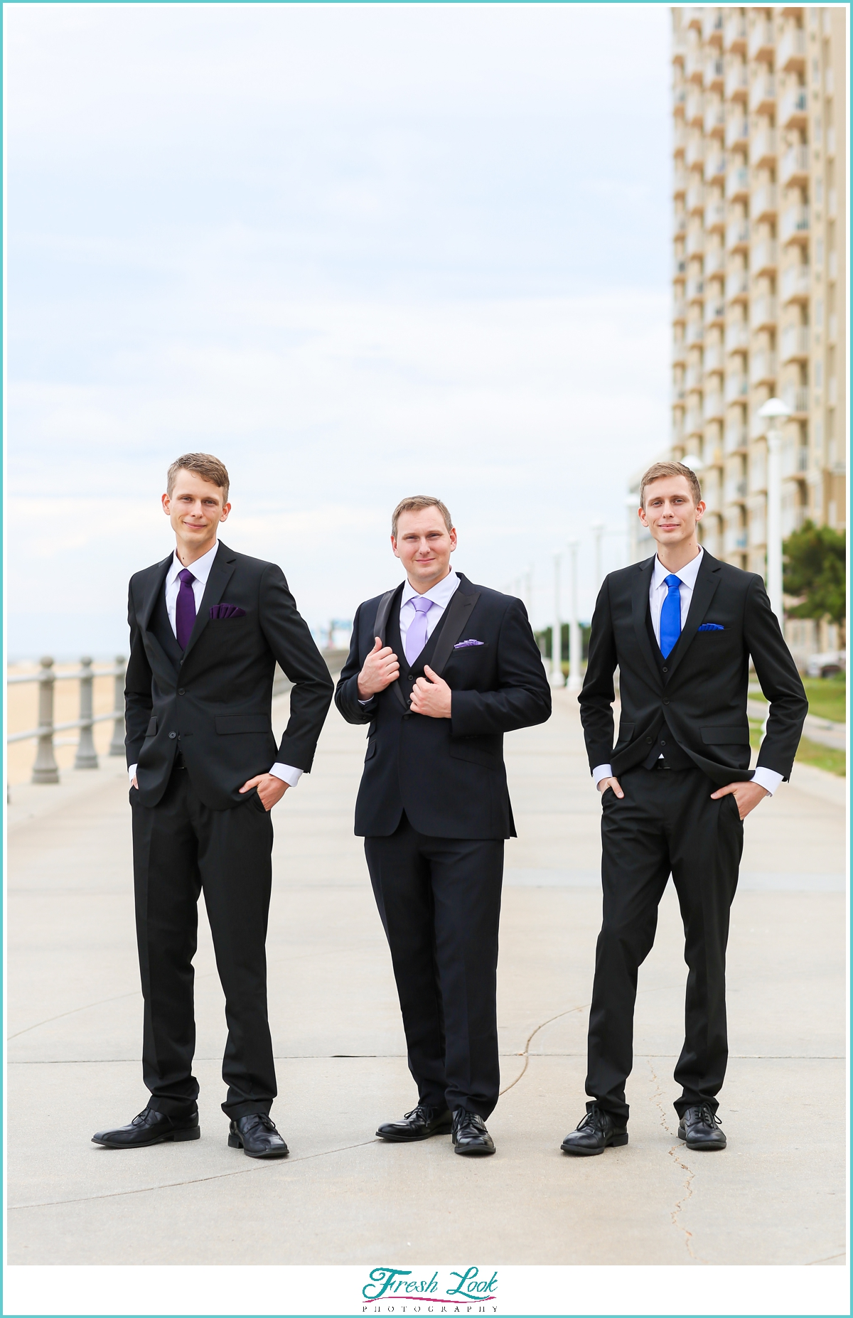 handsome groom and groomsmen wearing suits