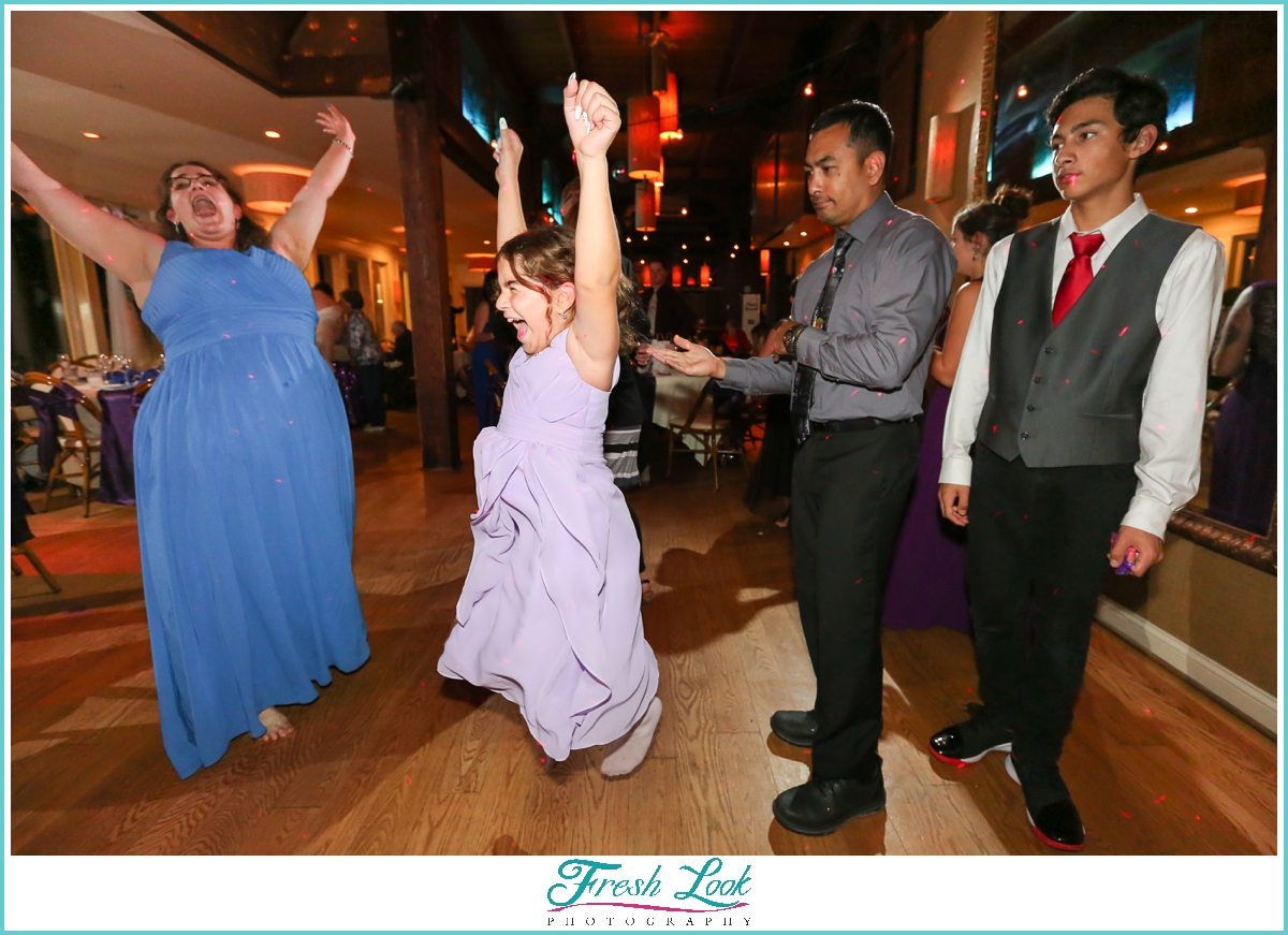 jumping for joy at wedding reception