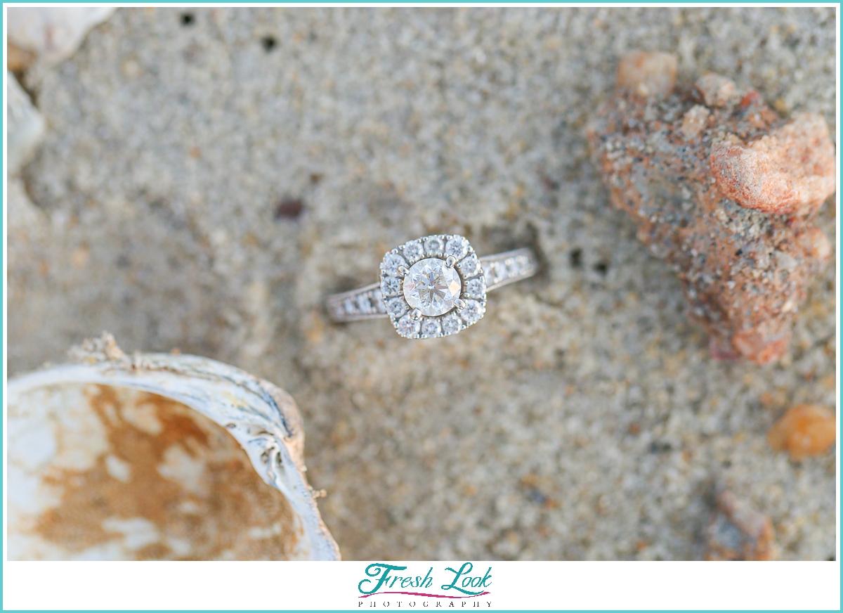 diamond engagement ring on the beach