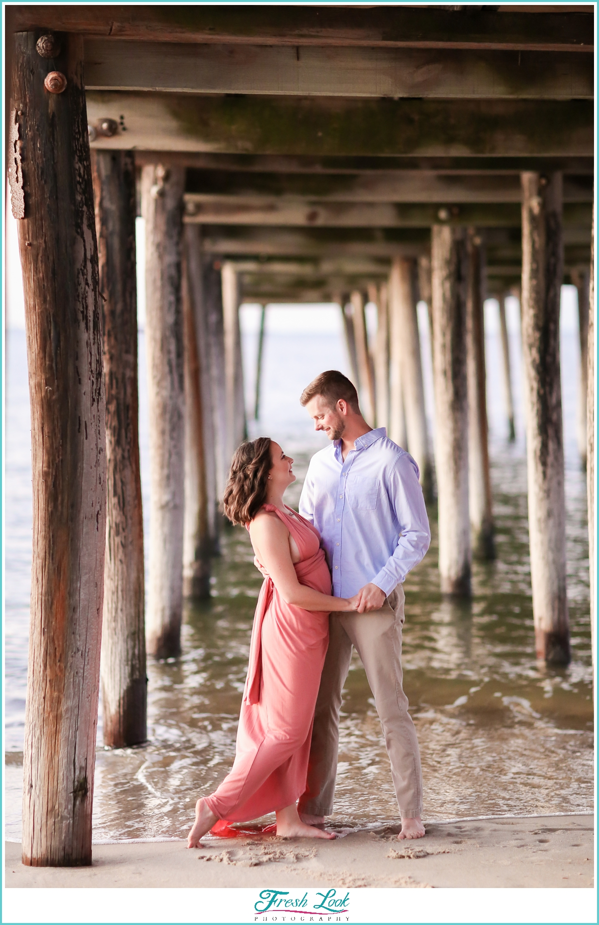 engagement photos under the pier
