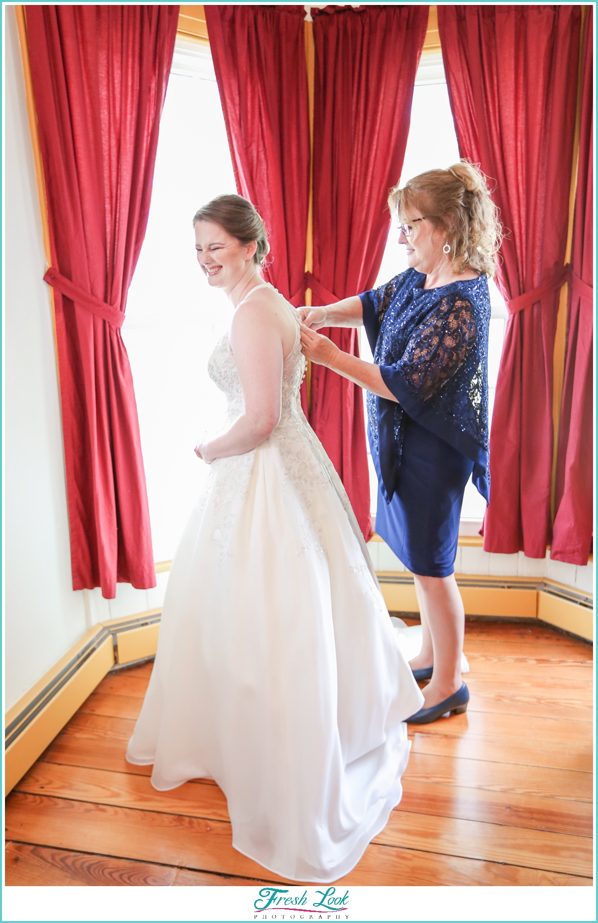 bride with mother before wedding ceremony