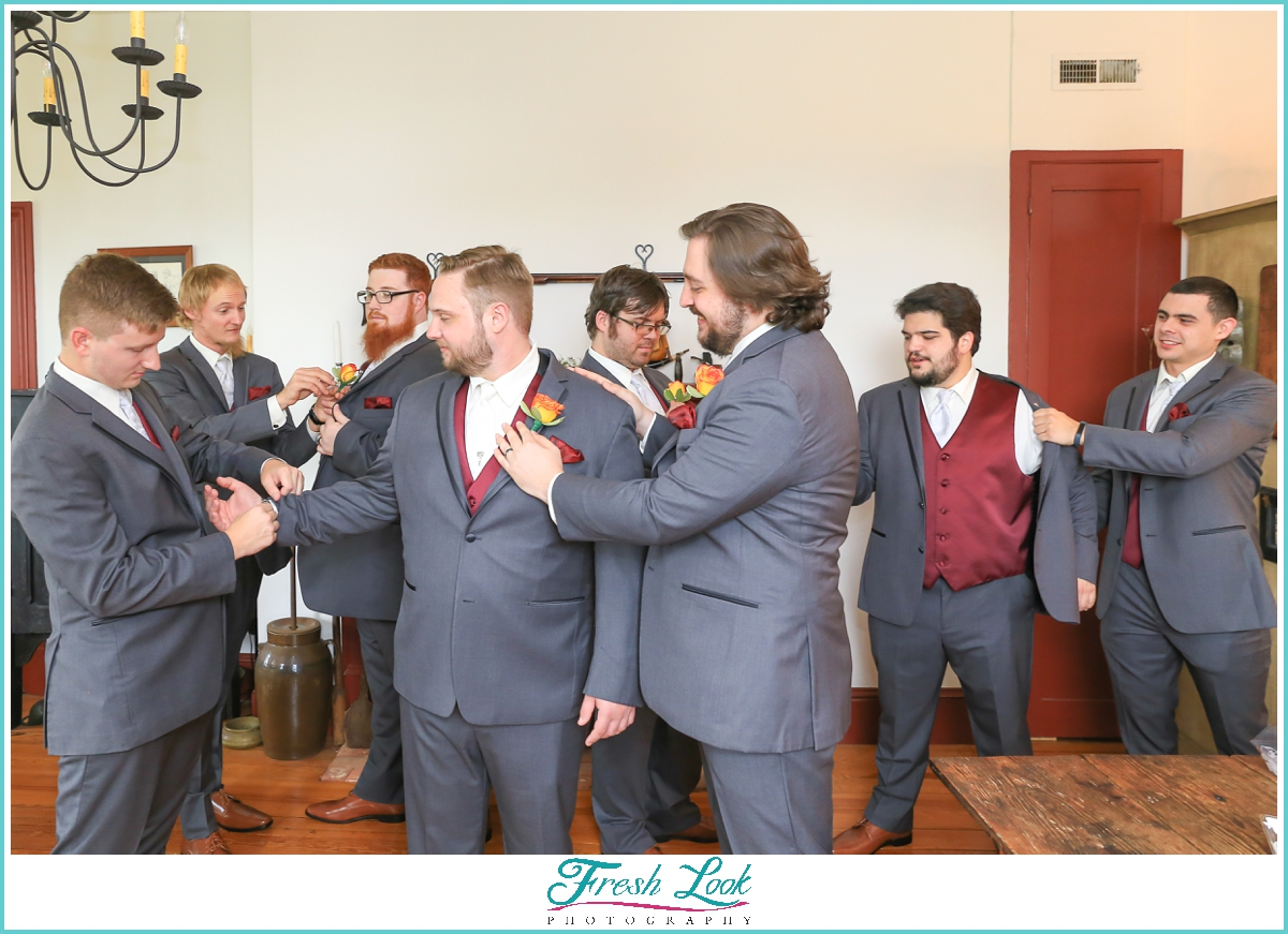 groom and groomsmen getting ready for the wedding