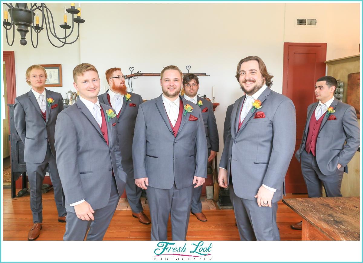 groom and groomsmen wearing gray suits