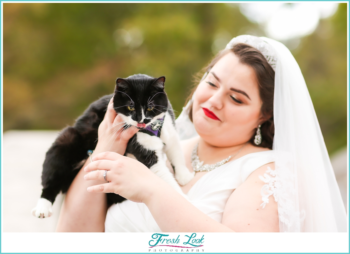 bride holding her cat during photoshoot