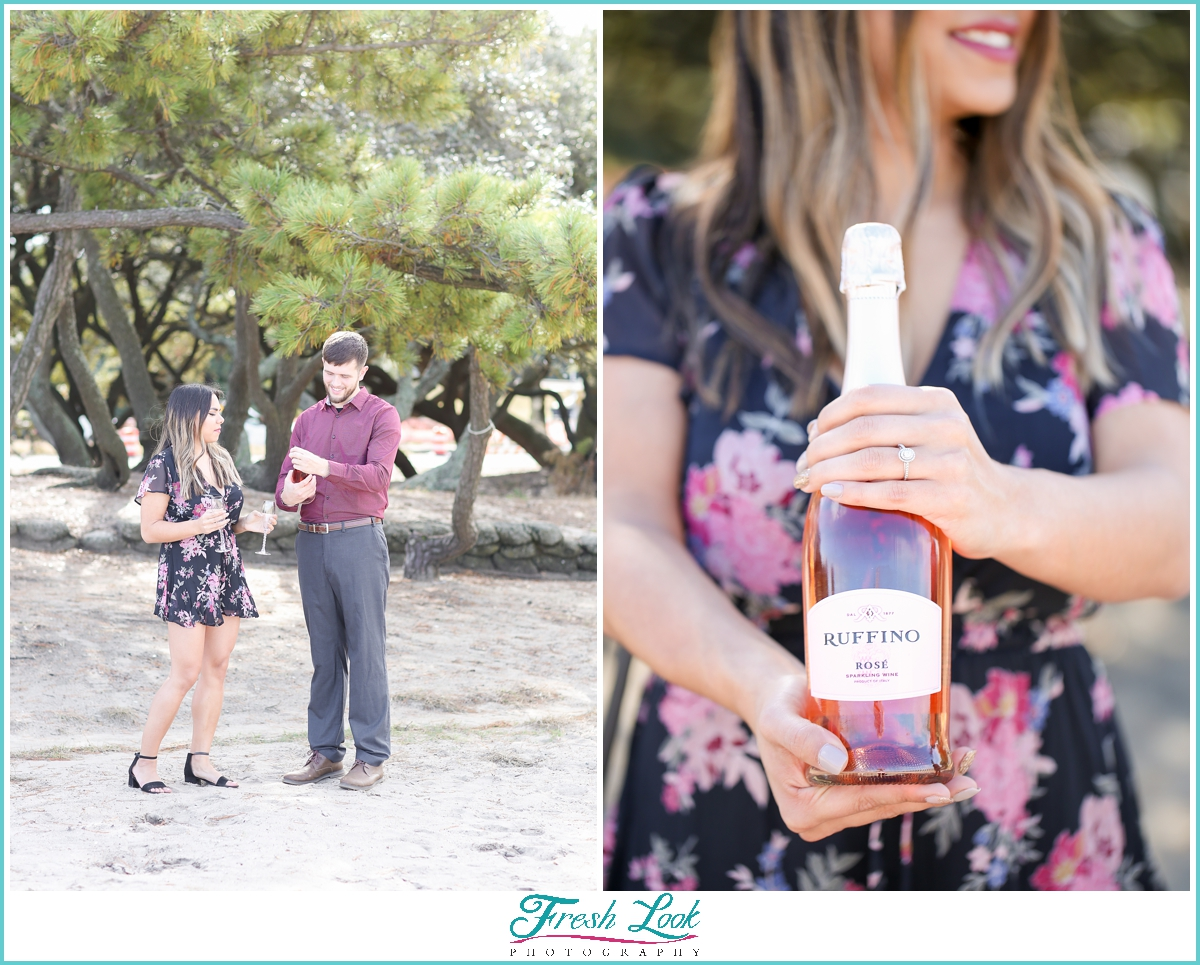 popping a bottle of champagne during photoshoot